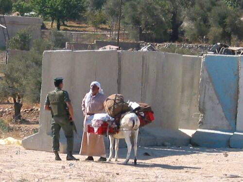 http://www.sfbayview.com/wp-content/uploads/bethlehem-checkpoint-soldier-stops-farmer-trying-to-bypass.jpg