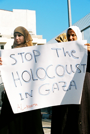 Despite Israel's divide-and-conquer effort to pit Palestinians in the West Bank and Gaza against each other, these young women in Bethlehem in the West Bank clearly condemn the Israeli attack on Gaza, describing it as a holocaust, suggesting the Israelis are doing to the Palestinians what the Nazis did to them. – Photo: Zachary Norris