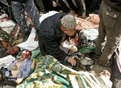 A Palestinian man cries over the body of his son following an Israeli air strike in Gaza Dec. 27. The Israeli attacks came at the time thousands of Palestinian children were in the streets on their way home from school.