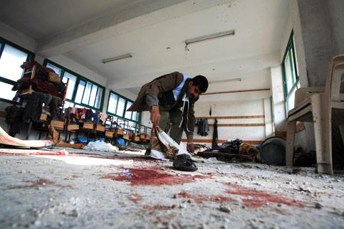 A Palestinian U.N. worker inspects debris Jan. 17 after an Israeli air strike on a U.N. school in Gaza where civilians were seeking refuge. – Photo: Wissam Nassar, MaanImages