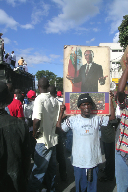 Haitian protesters' prime demand Dec. 16 was the return of their beloved President Jean Bertrand Aristide, who was kidnapped Feb. 29, 2004, by U.S. Marines and lives now in exile in South Africa. – Photo: ©2008 Jean Ristil, HIP