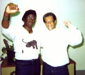 Herman Wallace and Albert Woodfox of the Angola 3 remain defiant after more than 36 years in solitary confinement. This photo was taken in 2002, the year after their comrade, Robert King Wilkerson, had been released. He continues to fight for their freedom.