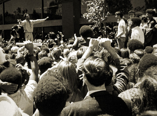 """Though Huey P. Newton, Ph.D., was a brilliant man who drew crowds whenever he spoke, he described himself as """"a rather shy individual. I wouldn't consider myself to be very charismatic; I never did anything hero-like, I just worked on some little community programs."""" This photo was taken on Aug. 5, 1970."""