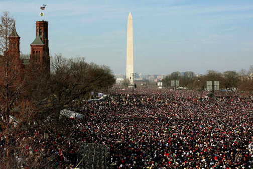 Millions standing in the cold on the Washington Mall watched President Obama take the oath of office and deliver his inaugural address and Rev. Lowery deliver the benediction – and millions more were watching around the world. – Photo: Mario Tama, Getty Images