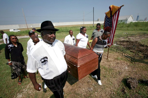 """In the Lower 9th Ward, the heart of New Orleans' Black culture, """"cleansed"""" post-Katrina of its people denied the rebuilding funds they were entitled to, tenacious residents hold a memorial ceremony on Aug. 29, 2008, the third anniversary of the storm, the coffin symbolizing its victims. – Photo: Lee Celano, Reuters"""