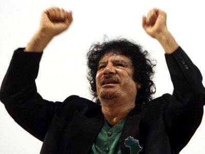 http://www.sfbayview.com/wp-content/uploads/muammar-qaddafi-hands-raised.jpg