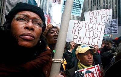 """Hundreds protested Friday for the second time in as many days outside New York Post headquarters, shouting, """"Boycott the Post! Shut it down!"""" and """"End racism now!"""" """"Since when can you call for the killing of the president of the United States?"""" demanded City Councilman Charles Barron. – Photo: Mario Tama, AFP Getty Images"""