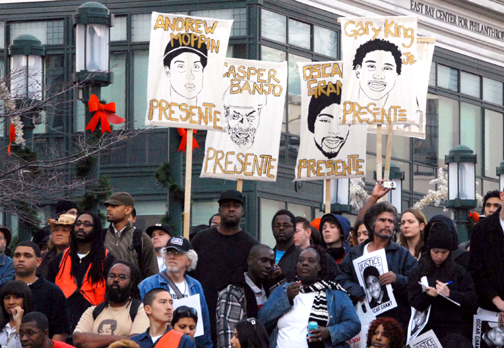 """At least 7,000 people packed the plaza outside Oakland City Hall for the Rally for Justice for Oscar Grant on Tuesday, Jan. 14. Their signs honoring several of the many Blacks recently murdered by police, these demonstrators represent a swing of public opinion toward justice and away from carte blanche """"law and order"""" police repression and terrorism. Legislators, take notice! – Photo: Bill Hackwell"""