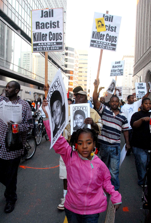 Children are marching in Oakland, too, protesting the police execution of Oscar Grant. Protesters in Oakland also face severe reprisals. This was the Jan. 14 march. – Photo: Bill Hackwell