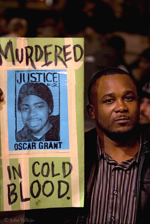 """Attorney General Holder recognized in his speech that he stands on the shoulders of Blacks """"who were lynched by the hundreds,"""" one of the most recent being Oscar Grant, murdered in cold blood by a BART police officer on New Year's in Oakland. – Photo: John Vallejo"""