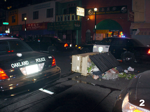 Dumpsters were pulled into the street Jan. 7 to slow the police. This is on Eighth Street between Madison and Broadway. – Photo: Dave Id, IndyBay