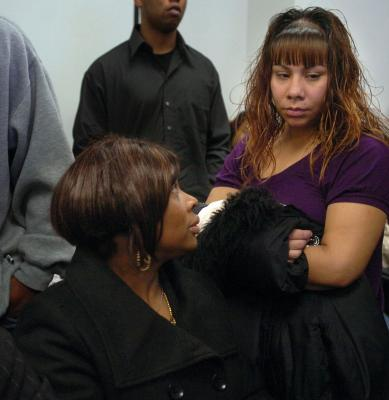 At a press conference Sunday called by John Burris, the family's attorney, Oscar Grant's mother, Wanda Johnson, and his daughter's mother, Sophina Mesa, comforted each other. – Photo: Dan Honda, Oakland Tribune