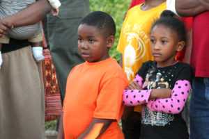 Two children of Paris listen intently to speakers at the rally. – Photo: Jesse Muhammad