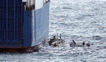 """Somali pirates – fishermen who have been forced out of their fishing grounds by foreigners – hijack the MV Faina on Sept. 24 in Somali waters. A Ukrainian cargo ship loaded with heavy weaponry, including 33 Russian-designed T-72 battle tanks, the Faina is still being held, for $35 million ransom, 89 days later. Newsweek quotes a leader of the pirates, interviewed by phone from the bridge of the Faina, who explains, """"If we are forced to avoid fishing our waters, then those [commercial] ships are all our fish."""""""
