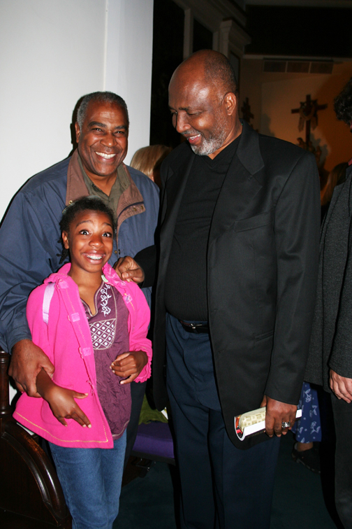Pierre Labossiere with his daughter Malaika glow in the presence of Father Gerry Jean-Juste when he spoke on Sept. 9, 2006, at St. Joseph the Worker Church in Berkeley. Everyone is invited to return there for his memorial on Saturday, June 27, at 7 p.m. The church is located at 1640 Addison in Berkeley. — Photo: Minister of Information JR